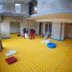 workers-installing-underfloor-heating-system