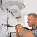 repairman-repairing-electric-boiler